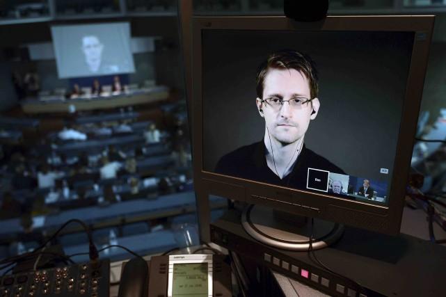 Edward Snowden (ici par vidéoconférence) a peu de... (AFP)