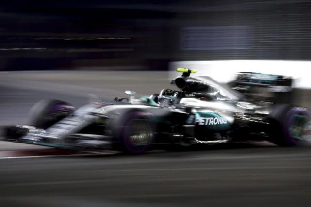 Le pilote Mercedes Nico Rosberg... (Yong Teck Lim, Associated Press)