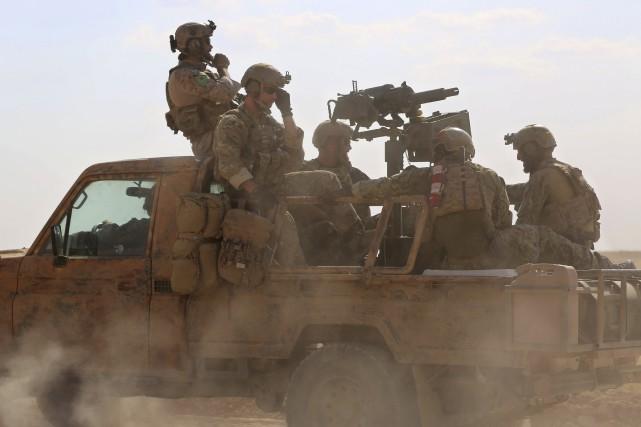 Au moins 60 soldats syriens seraient morts dans... (Archives AFP)