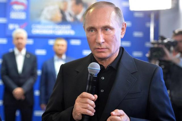 Vladimir Poutine a pris la parole lors d'une... (PHOTO AFP)
