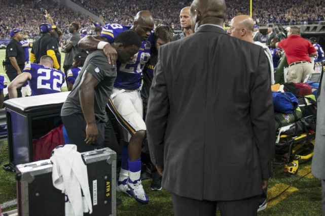 Adrian Peterson... (PHOTO STEPHEN MATUREN, AFP)