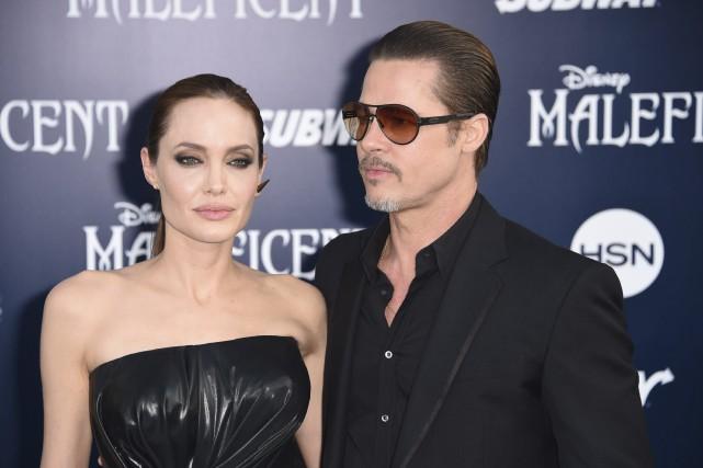 Angelina Jolie et Brad Pitt en mai 2014... (AFP, Robyn Beck)