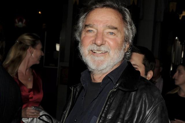 Le réalisateur Curtis Hanson arrive à la première... (AFP, Kevin Winter)