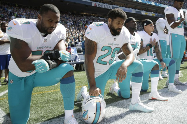 Jelani Jenkins, Arian Foster, Michael Thomas et Kenny... (Photo Stephen Brashear, AP)