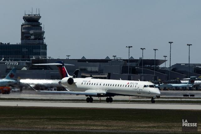 Un avion Delta s'apprête à décoller del'aéroport Montréal-Trudeau.... (PHOTO HUGO-SEBASTIEN AUBERT, ARCHIVES LA PRESSE)