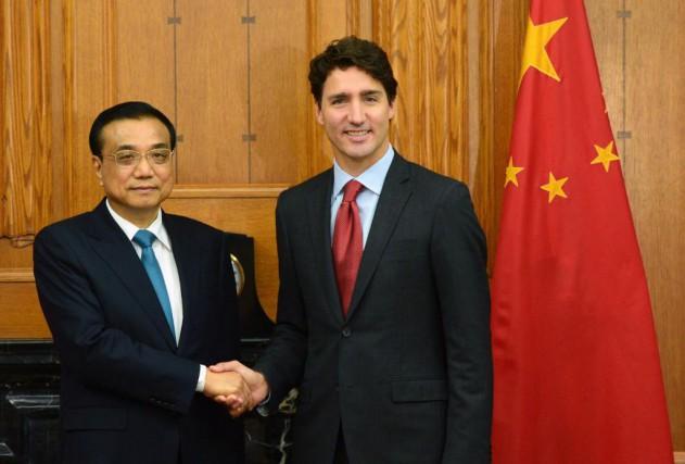 Le Premier Ministre du Conseil des Affaires d'État... (PHOTO SEAN KILPATRICK, LA PRESSE CANADIENNE)