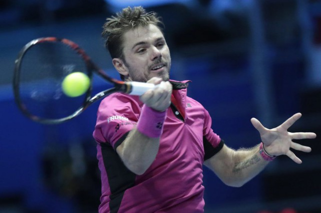 Stan Wawrinka... (PHOTO DMITRI LOVETSKY, AP)