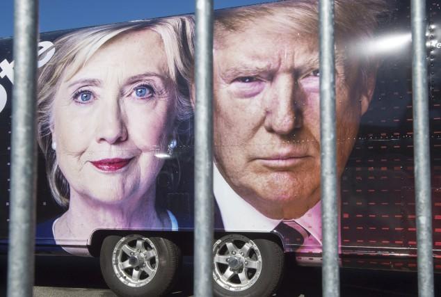 Les visages des candidats à l'élection présidentielle, Hillary... (AFP, Paul J. Richards)