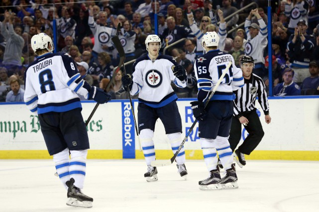Jacob Trouba, Tyler Myers et Mark Scheifele... (PHOTO Kim Klement, USA Today Sports)