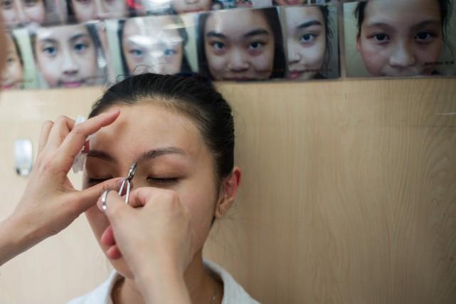 Li Chau-jingpense qu'elle peut modifier les destins grâce... (PHOTO AFP)