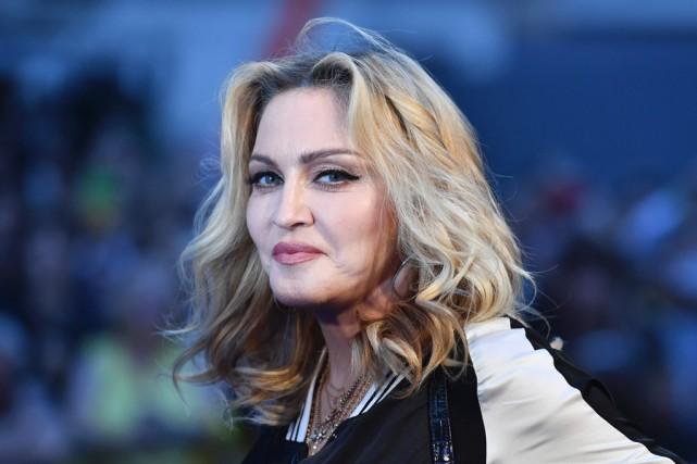 RDI relate la «vraie histoire» de Madonna, vendredi,... (Archives AFP)