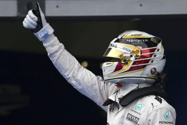 Lewis Hamilton... (MOHD RASFAN, AFP)