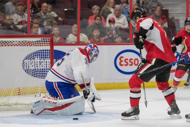 Le gardien du Canadien Al Montoya arrête un... (Photo Marc DesRosiers, USA Today Sports)