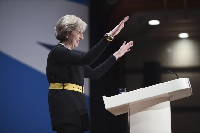 Theresa Maya annoncé dimanche qu'elle déclencherait d'ici à... (AFP, Oli Scarff)