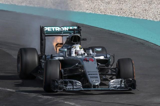 Lewis Hamilton a dominé le GP de Malaisie... (C.L. Donald Lim, AFP)
