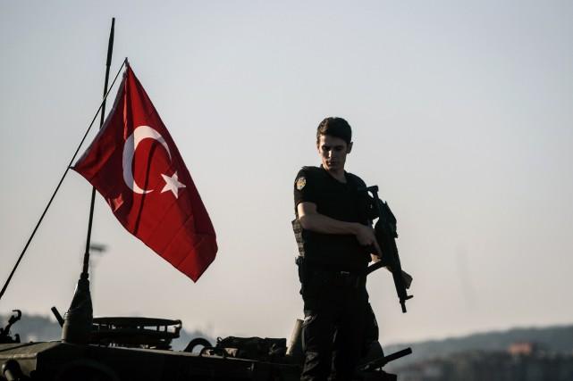 L'annonce de la mise à pied des policiers... (AFP)