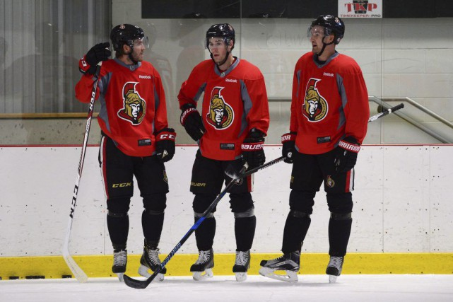 Mike Hoffman, Kyle Turris et Mark Stone lors... (Sean Kilpatrick, La Presse canadienne)