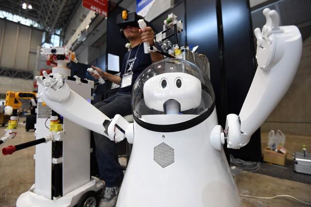 Le gouvernement espère attirer l'élite automatisée du monde... (PHOTO TORU YAMANAKA, ARCHIVES AFP)