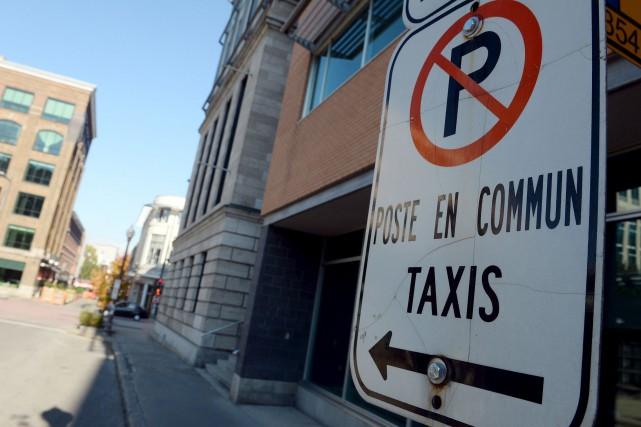 Les aires d'attente des taxis, qui d'habitude comptent... (Le Soleil, Erick Labbé)