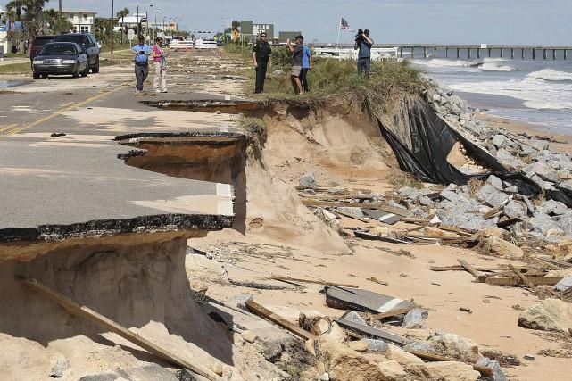 Après avoir dévasté Haïti, l'ouragan Matthew a fait... (AP, Stephen M. Dowell)