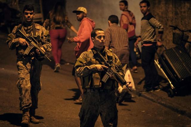 Au total, huit personnes ont été interpellées au... (PHOTO AFP)