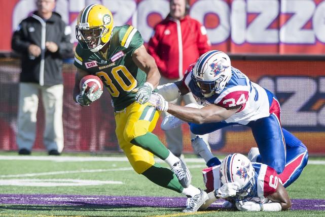 Le demi-offensif des Eskimos d'Edmonton John White a... (La Presse canadienne, Graham Hugues)
