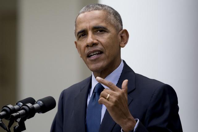 M. Obama a fait cette déclaration au moment... (AP)