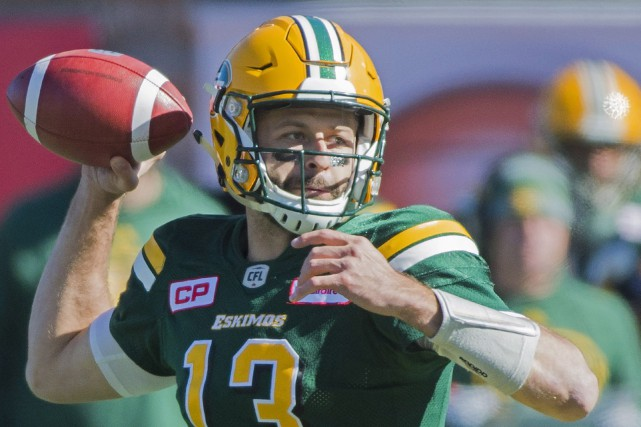 Le quart des Eskimos d'Edmonton Mike Reilly a... (Photo Graham Hughes, PC)