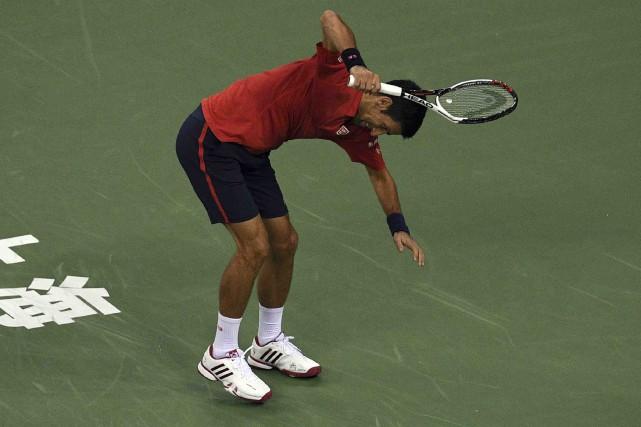 Novak Djokovic a commis 29fautes directes en demi-finales... (AFP, Johannes Eisele)