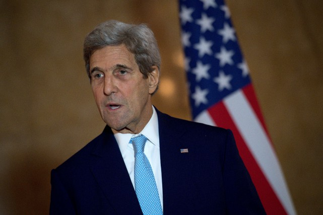 John Kerry... (PHOTO, JUSTIN TALLIS, REUTERS)