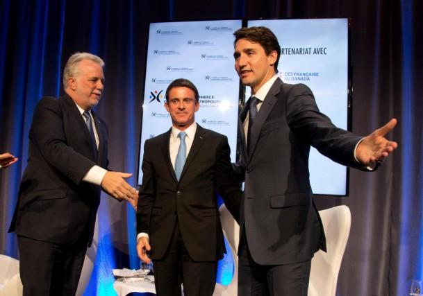 Philippe Couillard, le premier ministre français Manuel Valls... (PHOTO CHRISTINNE MUSCHI, REUTERS)