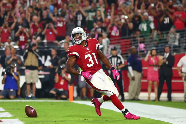 David Johnson a inscrit trois touchés dans la... (Photo Mark J. Rebilas, USA Today Sports)