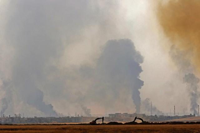 Sur cette photo prise depuis le village de... (photo SAFIN HAMED, AFP)