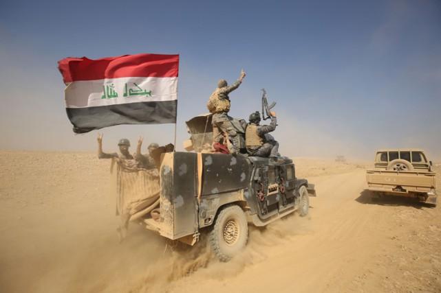 Avant d'atteindre les abords directs de Mossoul où... (PHOTO AFP)