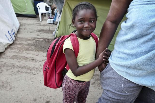 Comme cette petite fille, 270 enfants peuvent apprendre... (AFP, Louisa Gouliamaki)
