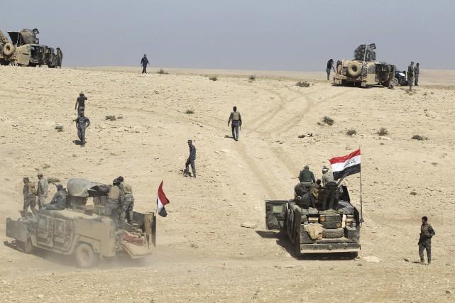 Les troupes irakiennesont gagné du terrain mardipour reprendre... (AFP, Ahmad Al-Rubaye)