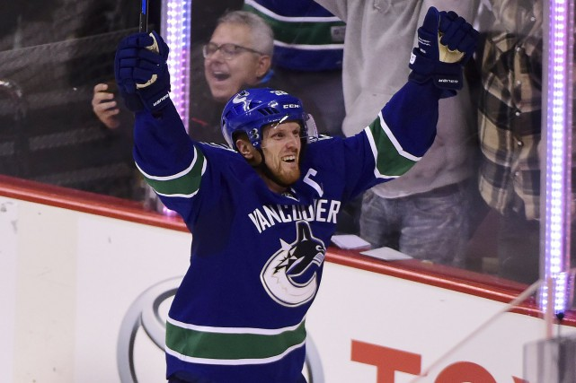 Henrik Sedin... (Photo Anne-Marie Sorvin, USA Today Sports)