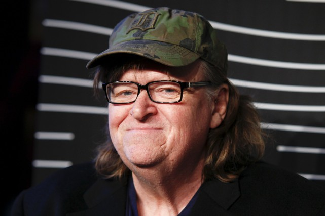 Le documentariste, Michael Moore... (Associated Press)
