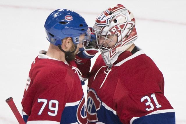 Carey Price et Andrei Markov ont célébré la... (La Presse canadienne, Graham Hughes)