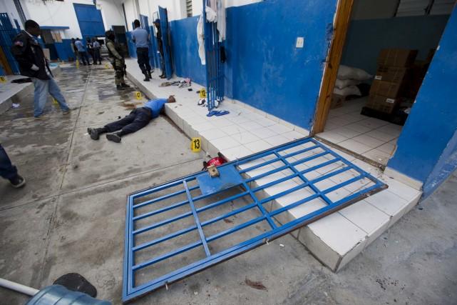 L'évasion de 172 prisonniers àArcahaie en Haïti a... (AP, Dieu Nalio Chery)