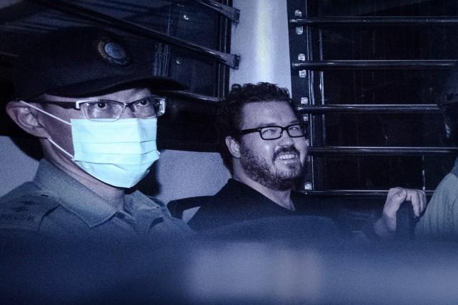 Rurik Jutting (à droite) a raconté dans un... (photo Philippe LOPEZ, archives AFP)