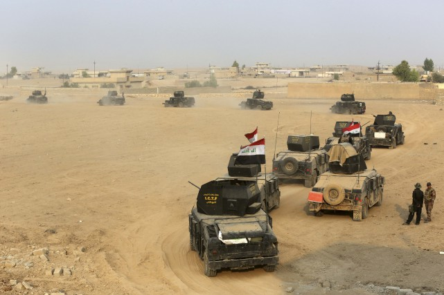 Les troupes d'élite irakiennes sont désormais positionnées à... (AP)