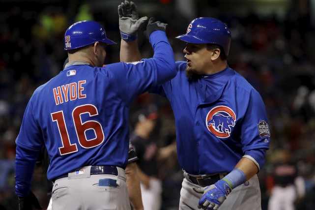 Les Cubs de Chicago ont battu les Indians... (Associated Press)