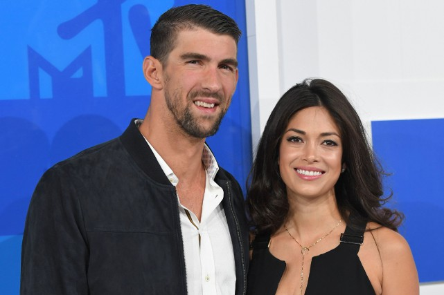 Michael Phelps et son épouse Nicole Johnson... (Photo Angela Weiss, AFP)