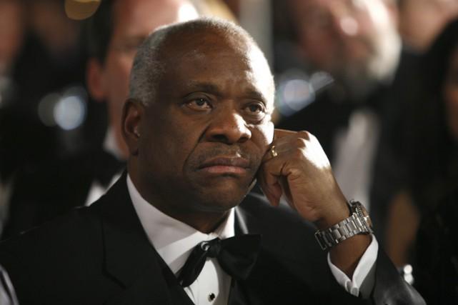 Clarence Thomas, seul Afro-Américain de la Cour suprême,... (ARCHIVES BLOOMBERG)
