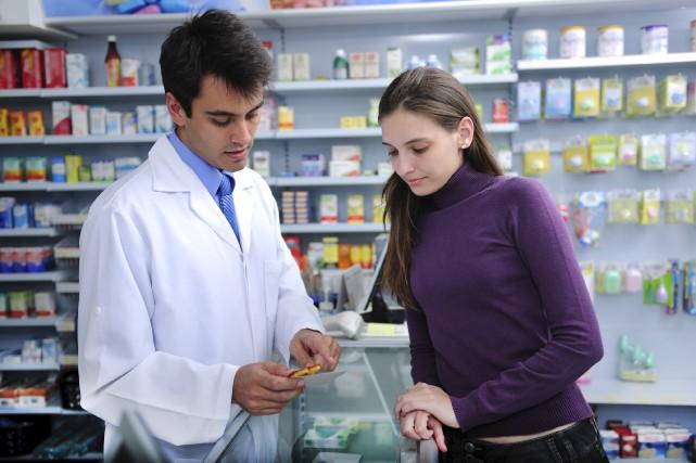 Les pharmaciens sont des professionnels de la santé,... (123rf)