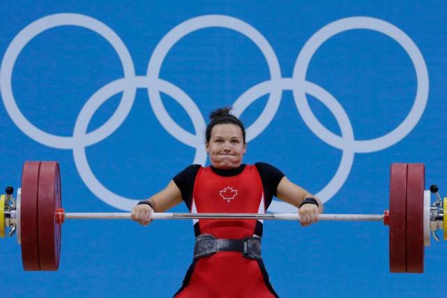 Christine Girard fut médaillée d'argent chez les moins... (Archives AP)