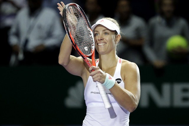 Angelique Kerber of Germany celebrates after beating Madison... (AP)