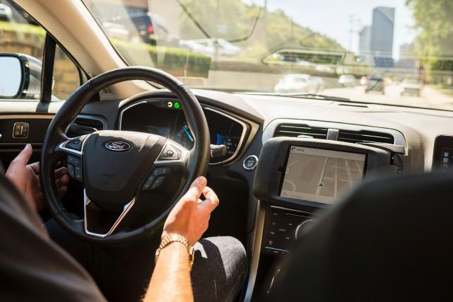 En vertu de l'entente, Uber devra verser une... (AFP)