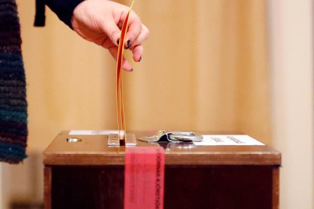 Si, comme l'anticipent les sondages, la coalition gouvernementale... (Photo Frank Augstein, AP)